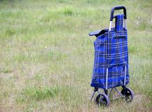 Shopping trolley bag. Blue shopping trolley bag keeping outdoor Royalty Free Stock Image