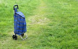 Shopping trolley bag. Blue shopping trolley bag keeping outdoor Royalty Free Stock Photography