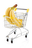 Shopping trolley and bananas Stock Photography