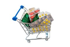 Shopping trolley with blisters of medical capsule pills Royalty Free Stock Image