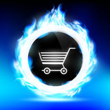 Shopping trolley burns with a blue flame. Round button with a shopping trolley burns with a blue flame Royalty Free Stock Photo