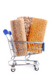Shopping trolley with carpet isoalted Royalty Free Stock Photography