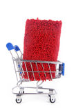 Shopping trolley with carpet Royalty Free Stock Photo