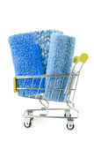 Shopping trolley with carpet Royalty Free Stock Images