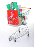 Shopping trolley cart. With present boxes and bags Royalty Free Stock Photography