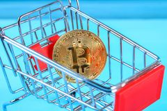 Shopping trolley cart with Coins bitcoin, buying goods for crypto currency. Shopping trolley cart with Coins bitcoin, buying goods for crypto currency Stock Image
