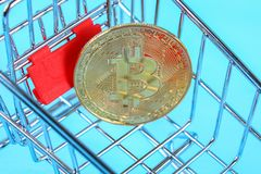 Shopping trolley cart with Coins bitcoin, buying goods for crypto currency. royalty free stock photos