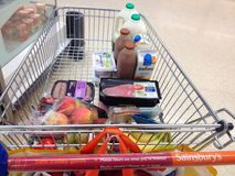 Shopping trolley or cart with food. Stock Photo