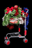 Shopping trolley of christmas decorations. On black background Royalty Free Stock Photo