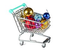 Shopping trolley with Christmas decorations isolated on white. Shopping trolley with Christmas decorations. Concept: preparation for the Christmas holiday Stock Image