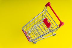 Shopping trolley on colorful background stock photography