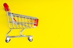 Shopping trolley on colorful background royalty free stock photo