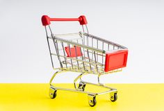 Shopping trolley on colorful background royalty free stock image