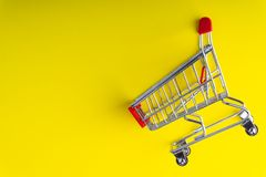 Shopping trolley on colorful background royalty free stock images