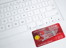 Shopping trolley and credit card on the keyboard Royalty Free Stock Photography