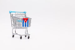Shopping trolley with Cuban flag. Stock Images