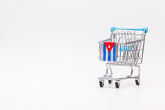 Shopping trolley with Cuban flag. Empty shopping trolley as a symbol of the financial crisis in Cuba Royalty Free Stock Photography