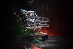 Shopping trolley on dark toned foggy background with some copy space. Empty shopping trolley on dark toned foggy background with some copy space. Financial Stock Photography