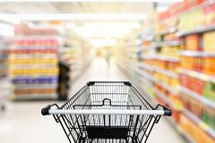 Shopping trolley in department store with consumer goods product Royalty Free Stock Photos