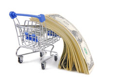 Shopping trolley with dollars Royalty Free Stock Photo