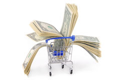 Shopping trolley with dollars Stock Photos