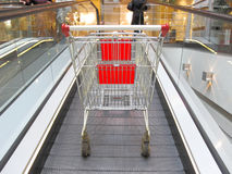 Shopping trolley on the elevator Royalty Free Stock Images