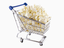Shopping trolley filled with popcorn. A shopping trolley filled with popcorn isolated Stock Photos