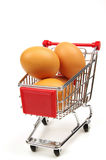 Shopping trolley and fresh eggs Stock Photos