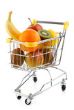 Shopping trolley and fruits. Shopping trolley full of fruits on white background Royalty Free Stock Photo