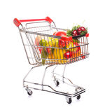 Shopping trolley with fruits. Isolated on white Royalty Free Stock Photography