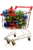 Shopping trolley full of christmas decorations 1. Red and silver shopping trolley full of multi coloured christmas decorations Stock Photography