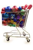 Shopping trolley full of christmas decorations 2. Red and silver shopping trolley full of multi coloured christmas decorations Stock Photo