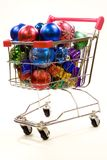 Shopping trolley full of christmas decorations 3. Red and silver shopping trolley full of multi coloured christmas decorations Stock Image