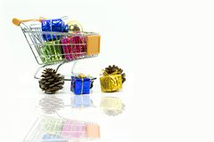 Shopping trolley with gift boxes with decoration Stock Photography