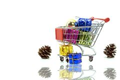 Shopping trolley with gift boxes with decoration Royalty Free Stock Photo