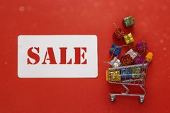 Shopping trolley with gift boxes and label with an inscription s Stock Photo