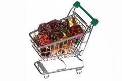 Shopping trolley with gifts Royalty Free Stock Photos