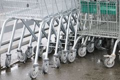 Shopping trolley group in supermarket car park royalty free stock image