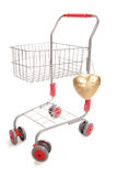 Shopping trolley with heart. Cutout Royalty Free Stock Photo