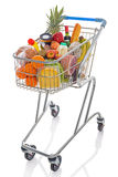 Shopping trolley isolated on white. Shopping trolley full of fresh groceries isolated on a white background Royalty Free Stock Photos
