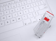 Shopping trolley on the keyboard Royalty Free Stock Image