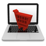 Shopping trolley on laptop Stock Image