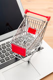 Shopping trolley with laptop Royalty Free Stock Image