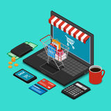 Shopping trolley on the laptop keyboard Royalty Free Stock Images