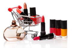 Shopping trolley with make-up products Royalty Free Stock Image