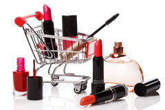 Shopping trolley with make-up products Stock Photos