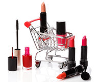 Shopping trolley with make-up products Royalty Free Stock Photography