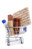 Shopping trolley with materials. Shopping trolley with various materials Stock Image