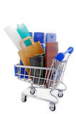 Shopping trolley with materials Royalty Free Stock Images