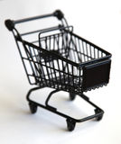 Shopping trolley. Metal shopping trolley on white background Royalty Free Stock Photos